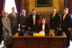 Governor Reynolds signs property tax bill